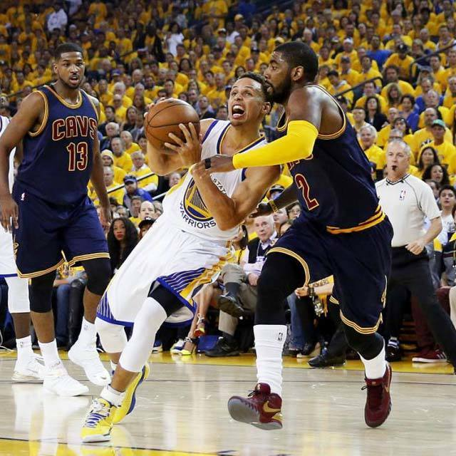 Stephen Curry #30 of the Golden State Warriors drives against Kyrie Irving #2 of the Cleveland Cavaliers in the first quarter during Game One of the 2015 NBA Finals at ORACLE Arena on June 4, 2015 in Oakland, California.