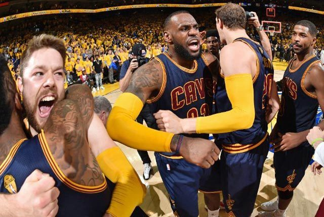LeBron James puts up a triple-double, Matthew Dellavedova hits two key FTs and Cleveland scratches out a 95-93 overtime win over Golden State.